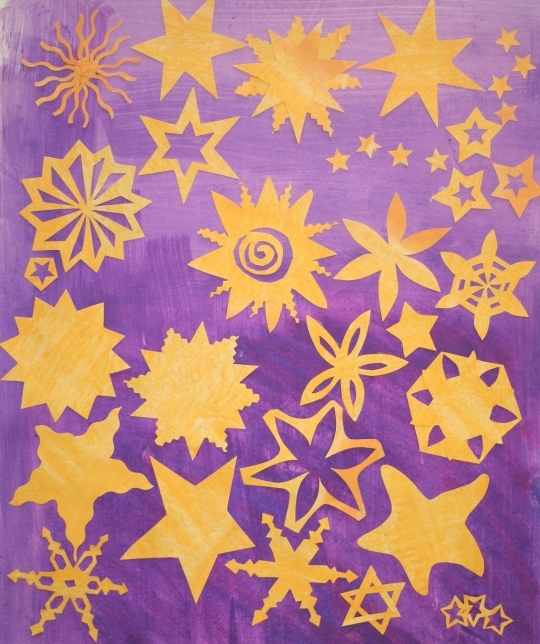Star shapes inspired by nature and the man-made world using coloured paper.